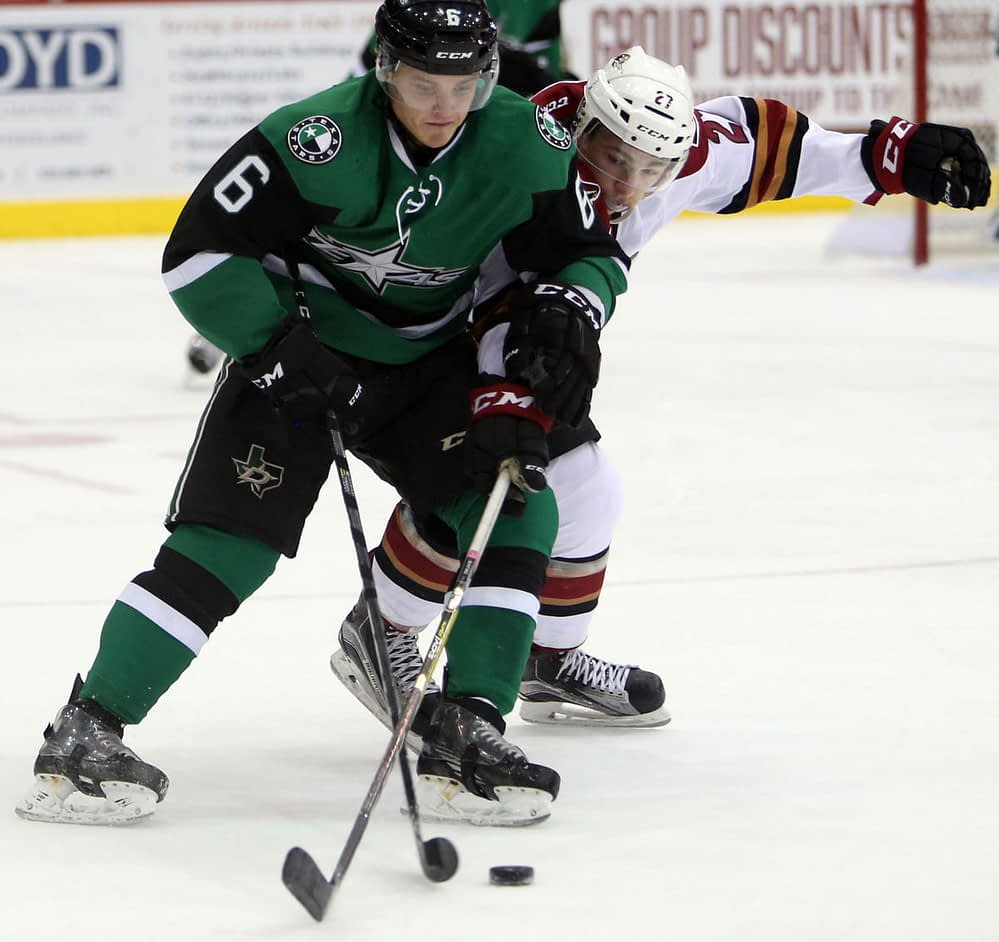 Julius Honka protects the puck from Michael Bunting. Source: Arizona Daily Star