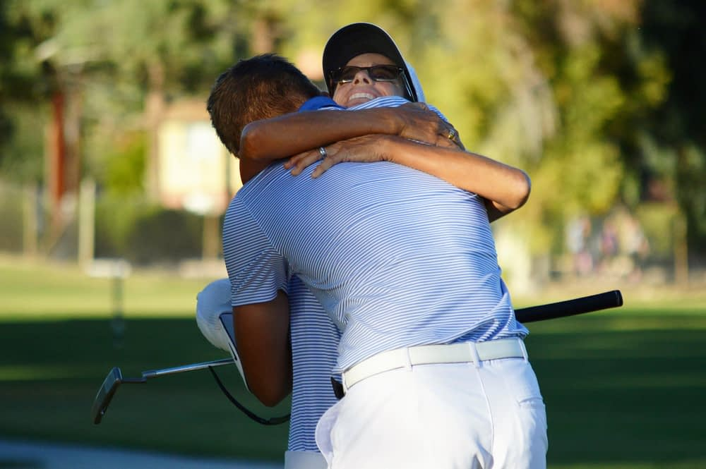 Gavin Cohen and Catalina Foothills head coach Julie Walters celebrate after Cohen clinched a n individual and team title (Andy Morales/AllSportsTucson.com)