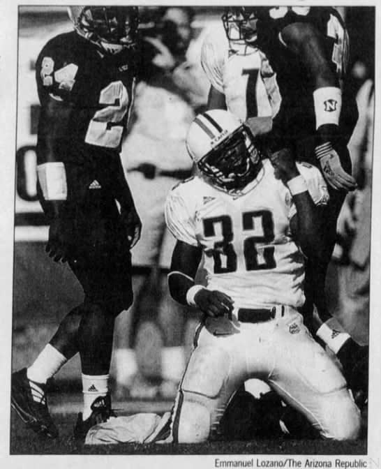 Arizona Republic clipping of Arizona running back Clarence Farmer celebrating during the Wildcats' 34-21 win over ASU in 2001