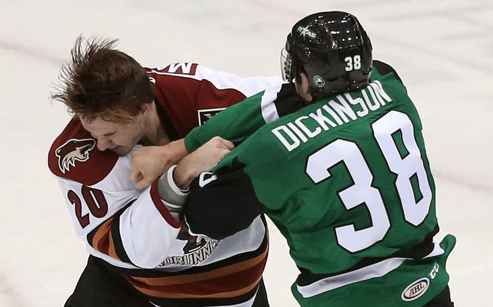 Ryan MacInnis in the heat of his second period fight against Jason Dickinson Source: Arizona Daily Star