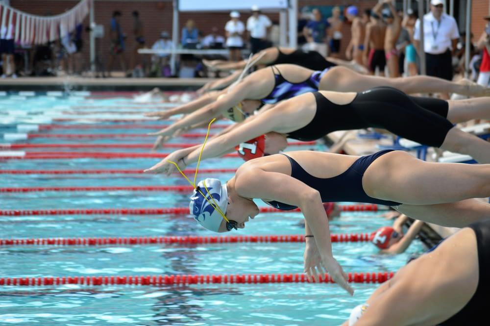 Hannah Houlton (Ironwood Ridge), Ruby Bottai (Tucson) and Kaylin Farnum (Sabino) start the 100 Free (Andy Morales/AllSportsTucson.com)