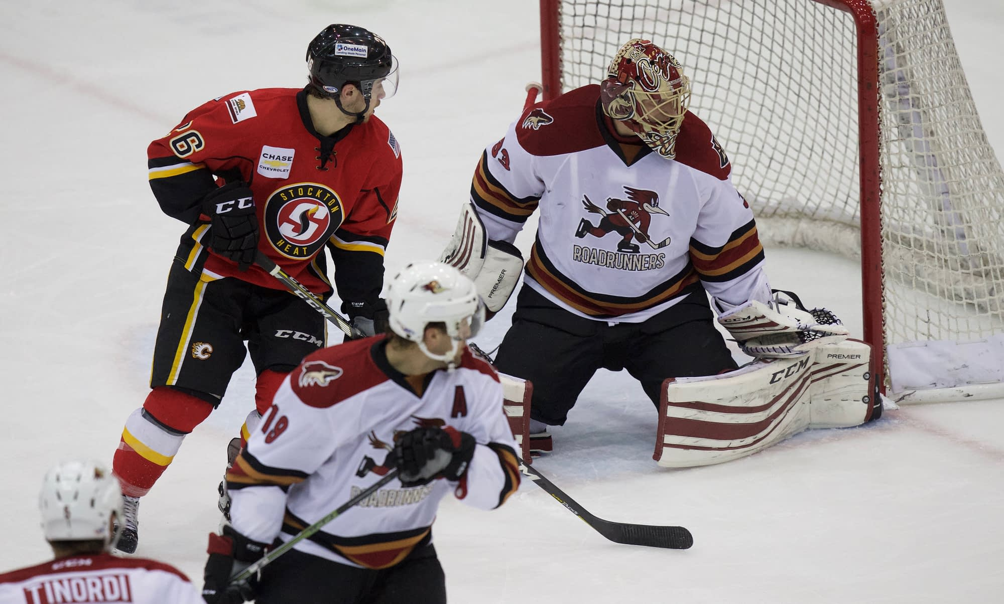 Adin Hill and Chris Mueller in action against the Stockton Heat Source: tucsonroadrunners.com