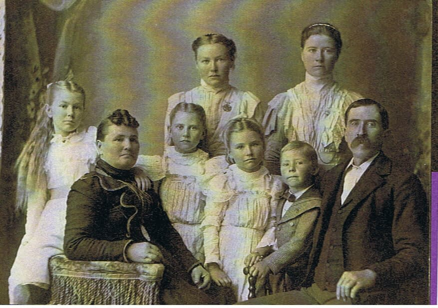 Maggie on far left with her family