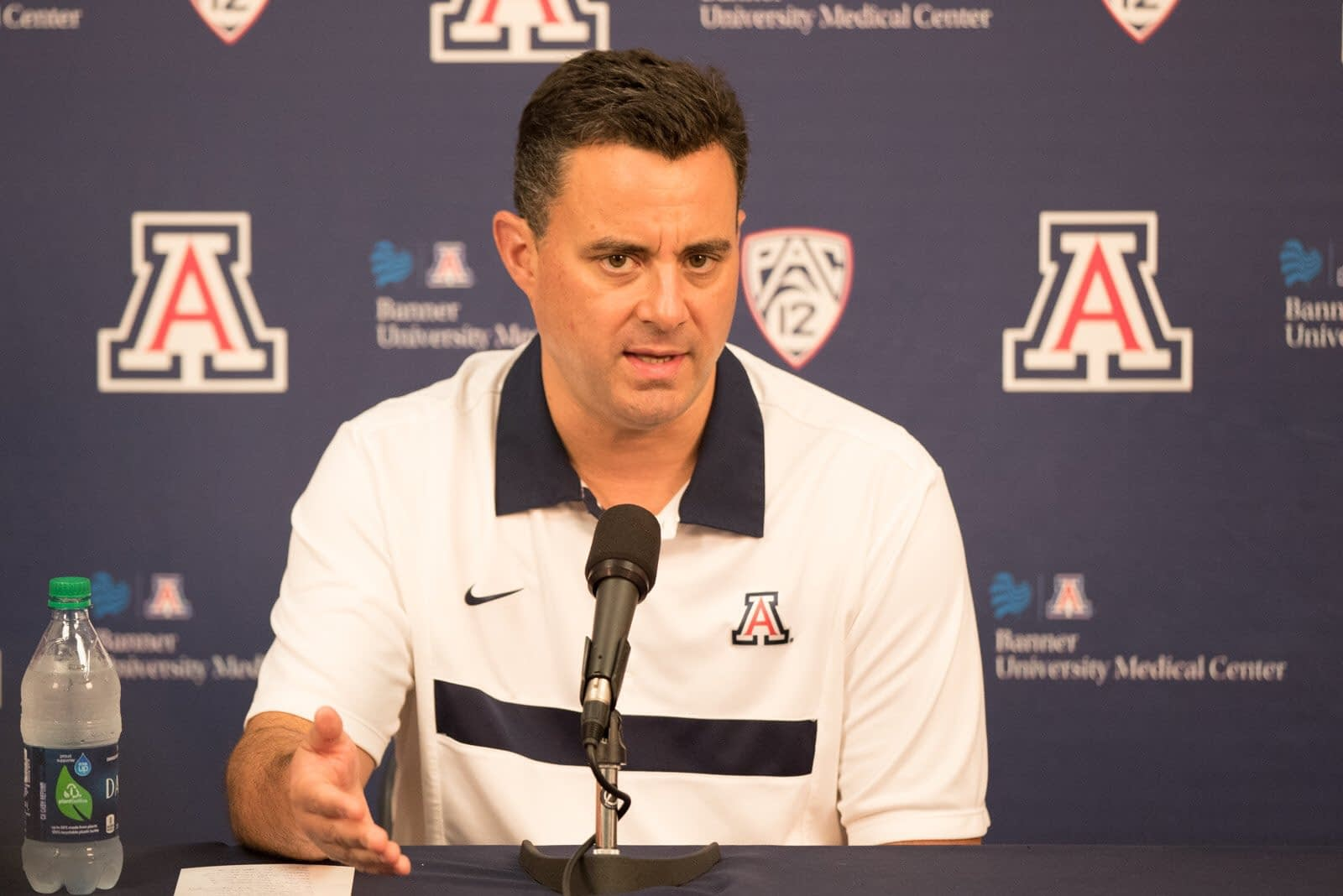 Sean Miller addresses the media (Photo via Arizona Athletics)